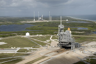 STS-129 on launch pad with Ares in the background