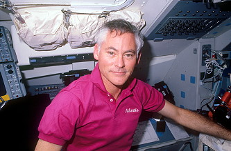 Mullane onboard Space Shuttle